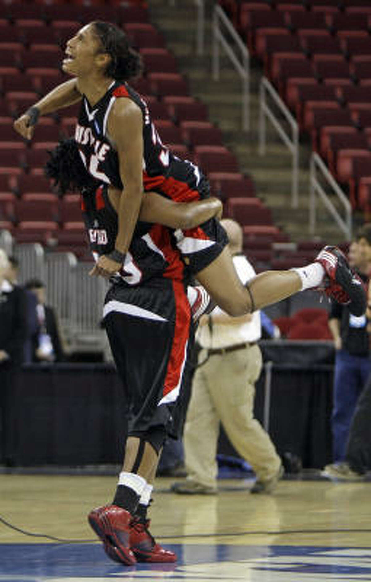 Raleigh (N.C.) Region, Regional Finals: Louisville 77, Maryland 60 Louisville's Deseree' Byrd lifts Angel McCoughtry following a women's NCAA college basketball tournament regional championship game.