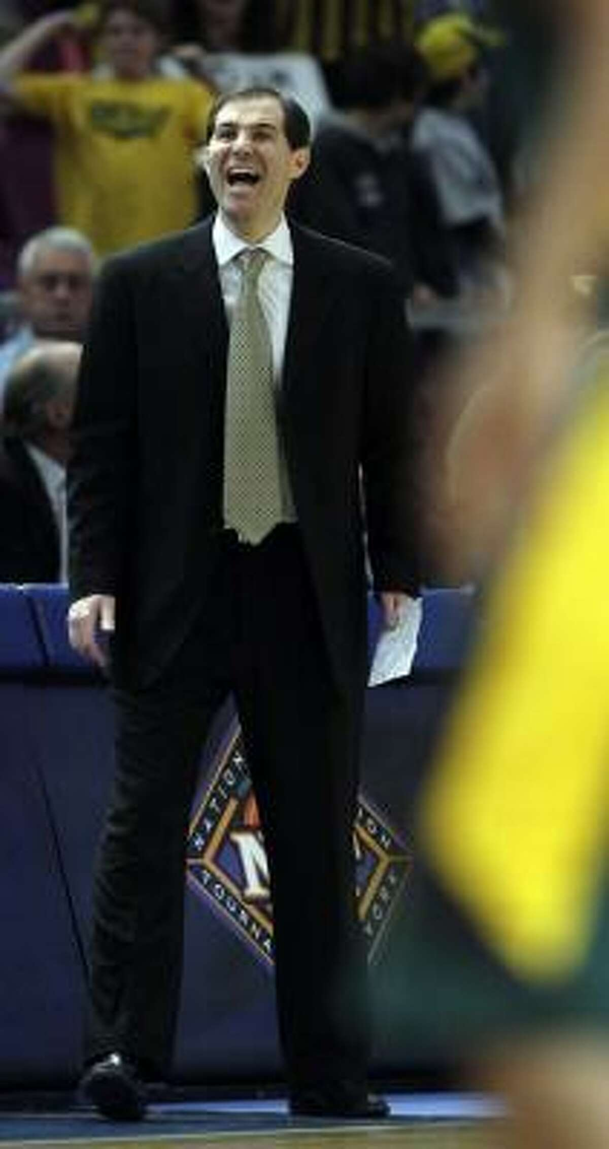 Baylor's head coach Scott Drew yells to his team during the second half of the NIT semifinal college basketball game against San Diego State. Baylor won the game 76-62.