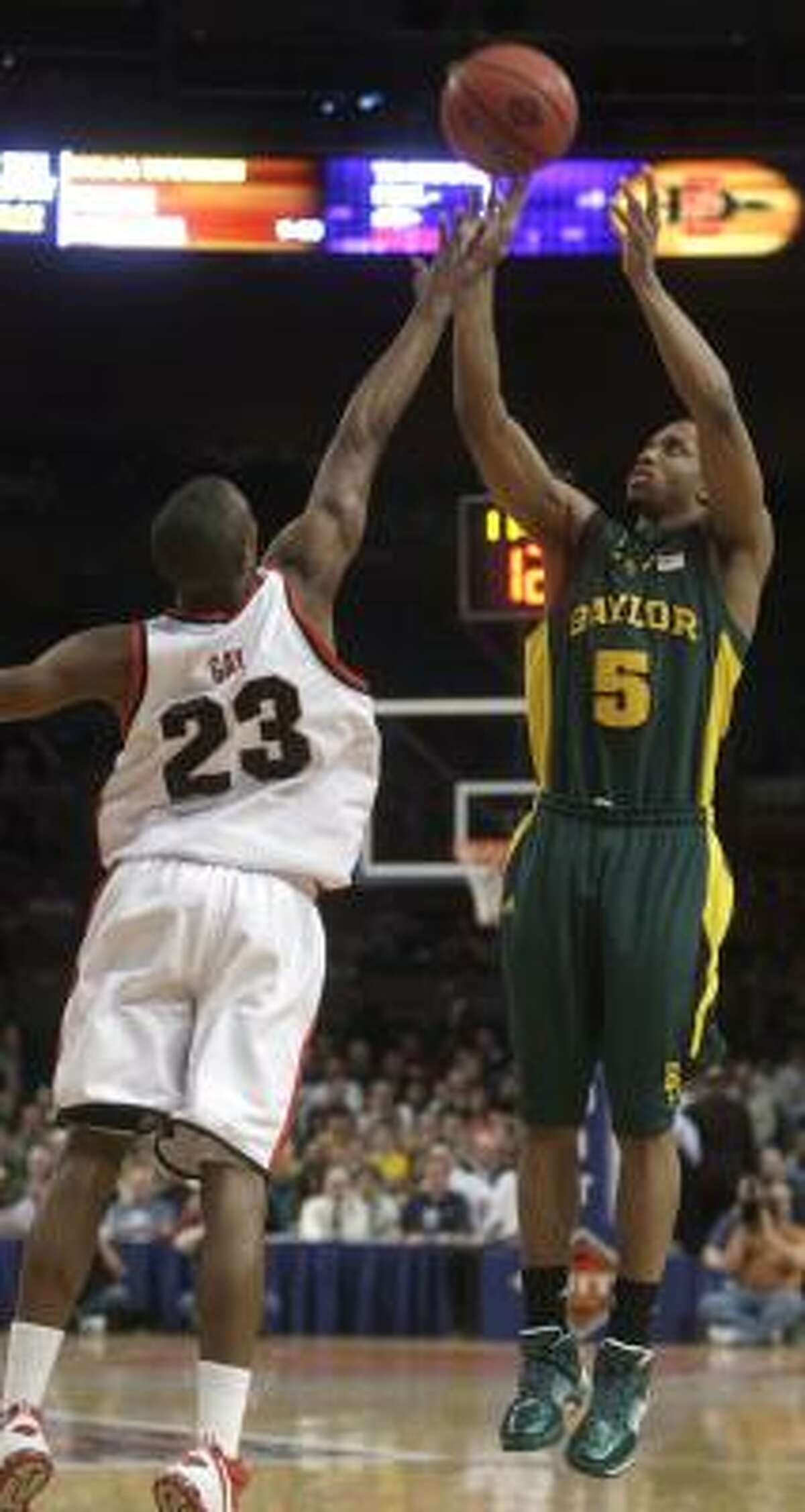 Baylor's Denis Clemente (5) shoots over San Diego State's D.J. Gray (23) during the first half.