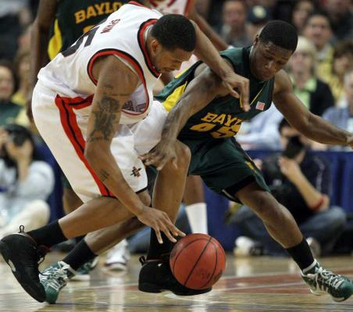 San Diego State's Kyle Spain (15) fights for control of the ball with Baylor's Darren Kent (45).