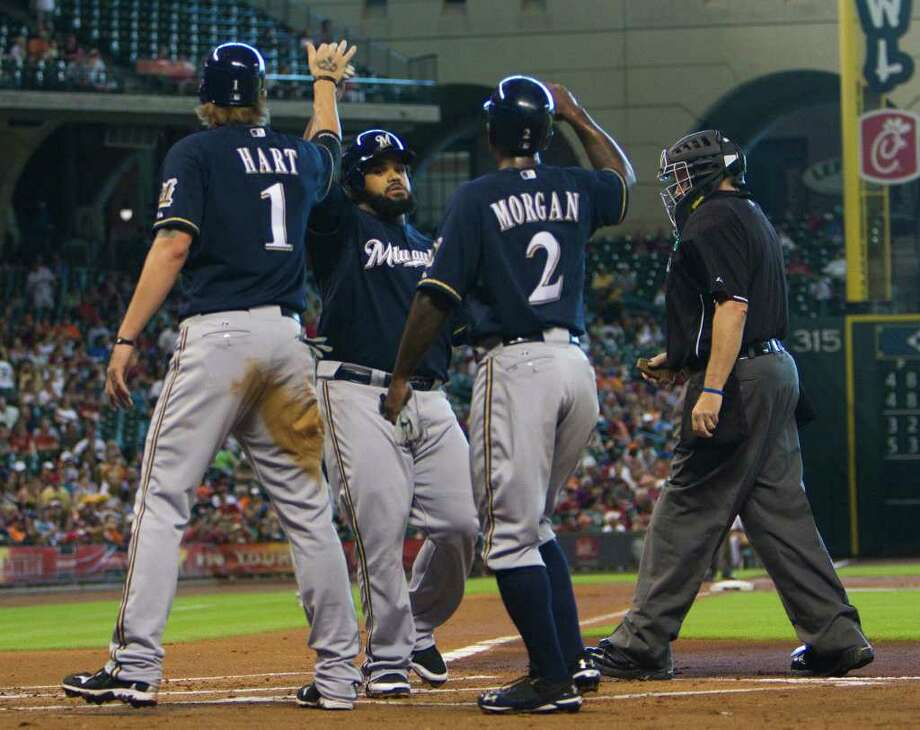 Milwaukee Brewers Corey Hart (1), Prince Fielder, center, and Nyjer Morgan (2) celebrate after Fielder's home run in the first inning of a baseball game against the Houston Astros, Saturday, Aug. 6, 2011, in Houston. Photo: Jon Eilts/Associated Press