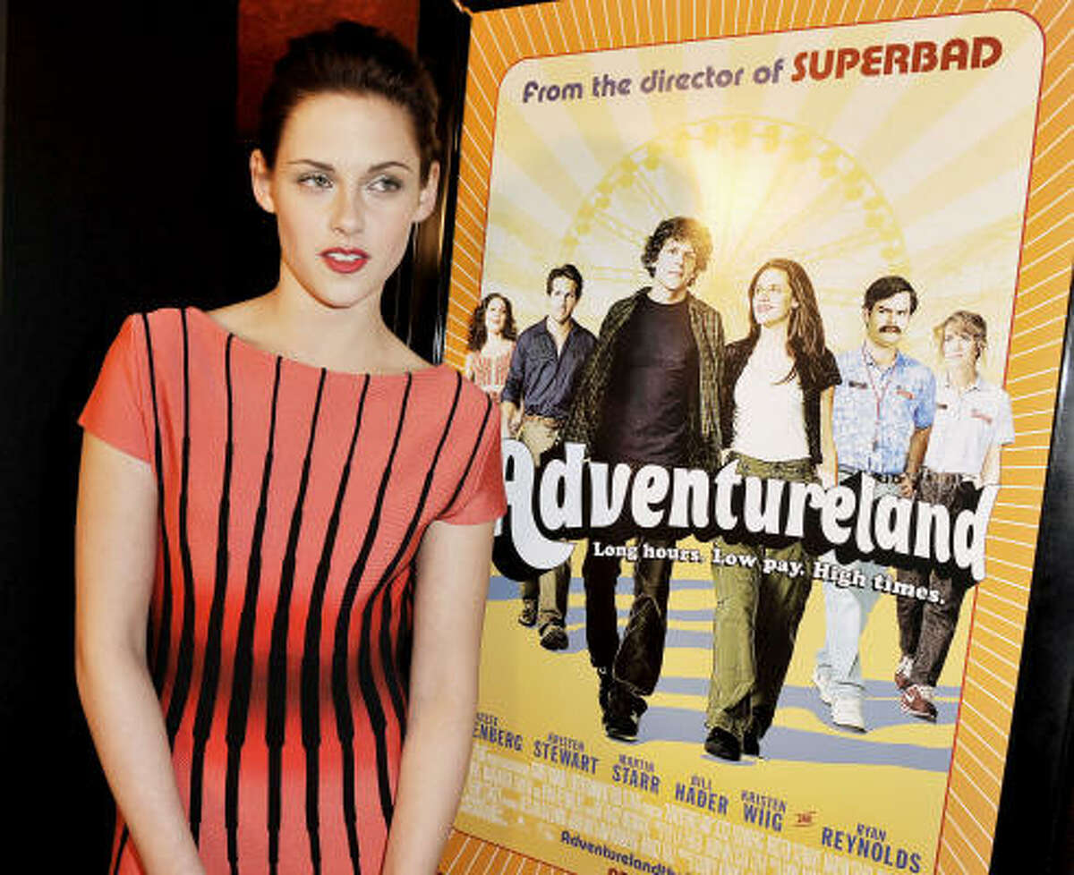 In Adventureland, Kristen Stewart plays Em Lewin, a young woman who works at the titular amusement park.