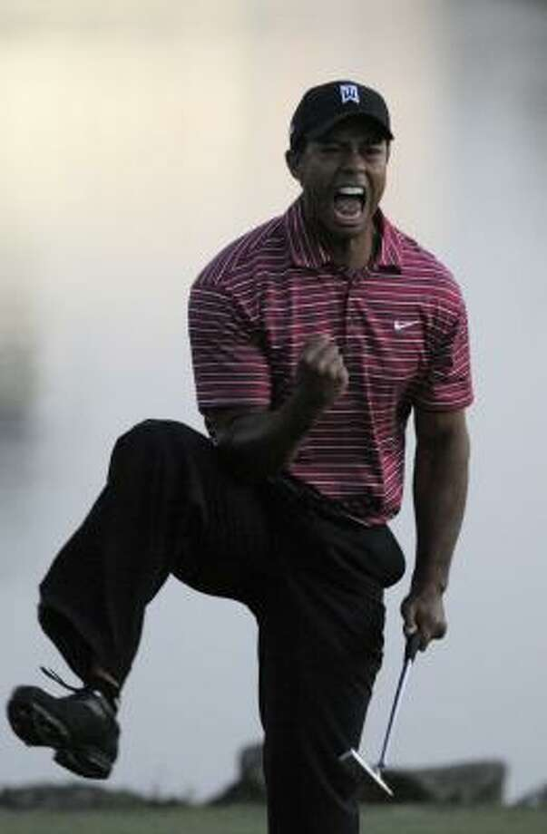 Tiger Woods celebrates after sinking the putt to win the Arnold Palmer Invitational at Bay Hill in Orlando, Fla.  Woods closed with a 3-under 67 for a one-shot victory over Sean O'Hair. Photo: Phelan M. Ebenhack, AP
