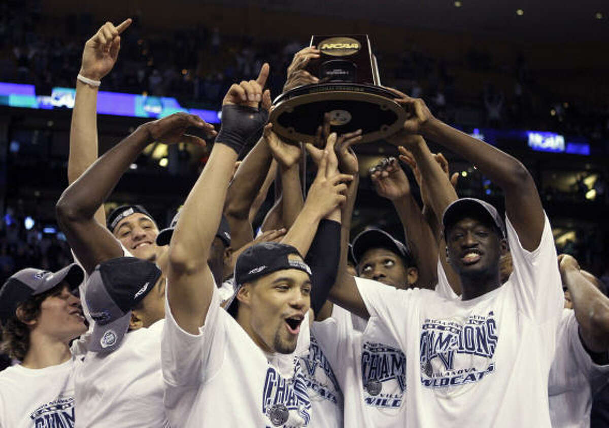 East Region: Villanova 78, Pittsburgh 76 Villanova players celebrate with the trophy after defeating Pittsburgh to win the East Region.