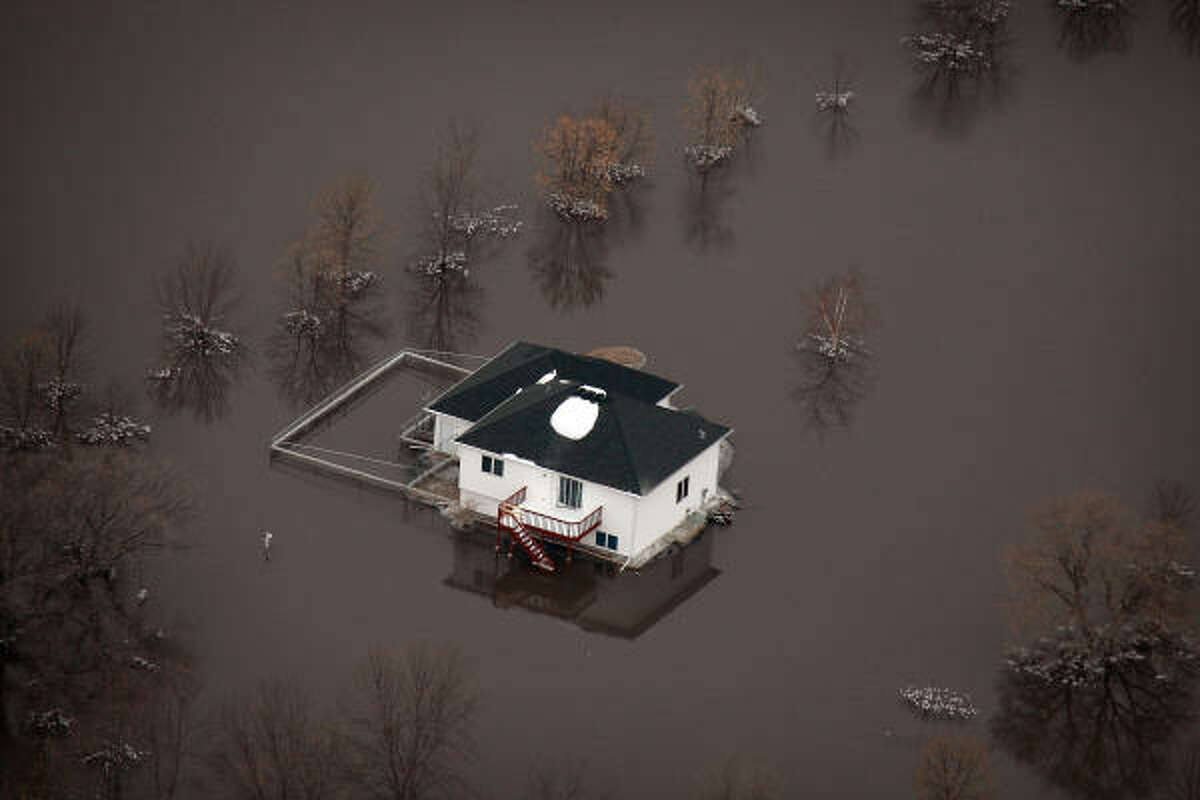 A home is surrounded by flood water from the Red River March 29, 2009 near Fargo, North Dakota. As flood waters from the Red River began to recede in Fargo and the surrounding communities residents believe that the worst of the flooding may have past, but are being cautioned by state and local authorities not to let down their guard yet.