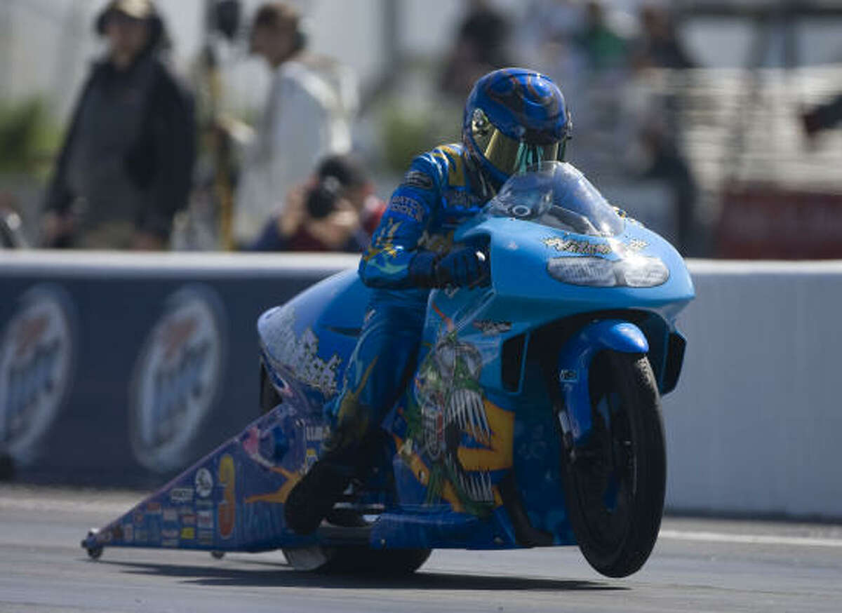 Matt Smith races his Suzuki in the pro stock motorcycle division.