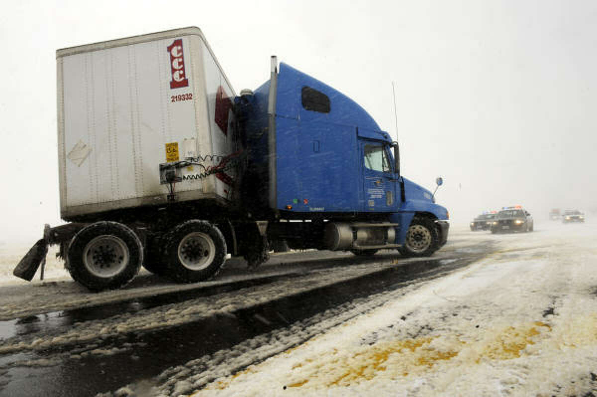 A semi-truck sits on the edge of Loop 335 in Amarillo.