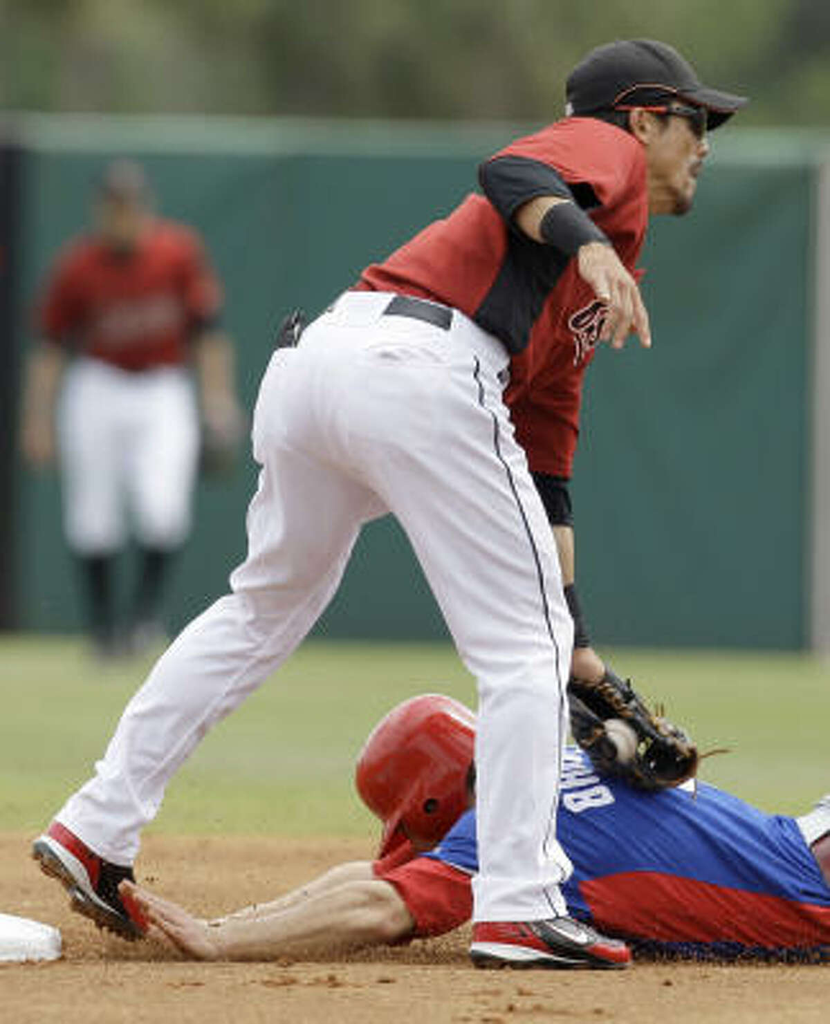 Phillies infielder Eric Bruntlett is tagged out by Astros second baseman Kazuo Matsui during an unsuccessful steal attempt in the first inning. Bruntlett was thrown out by Astros catcher Ivan Rodriguez.