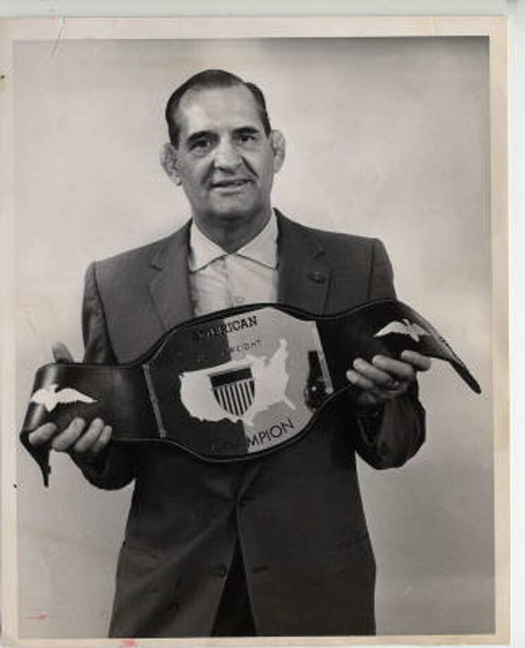 "Paul Boesch, shown here with his 1962 title belt, became a respected match promoter and popular ringside television commentator. ""He was a cut above,"" remembered Eldridge Coleman, 65, who wrestled in Houston in the 1970s and '80s. ""First, he was a genius in promotion and, secondly, he was a gentleman. That's extremely rare in the sordid business of pro-wrestling. ... He'd pay you, and he'd actually pay you in cash."" Photo: Chronicle File"
