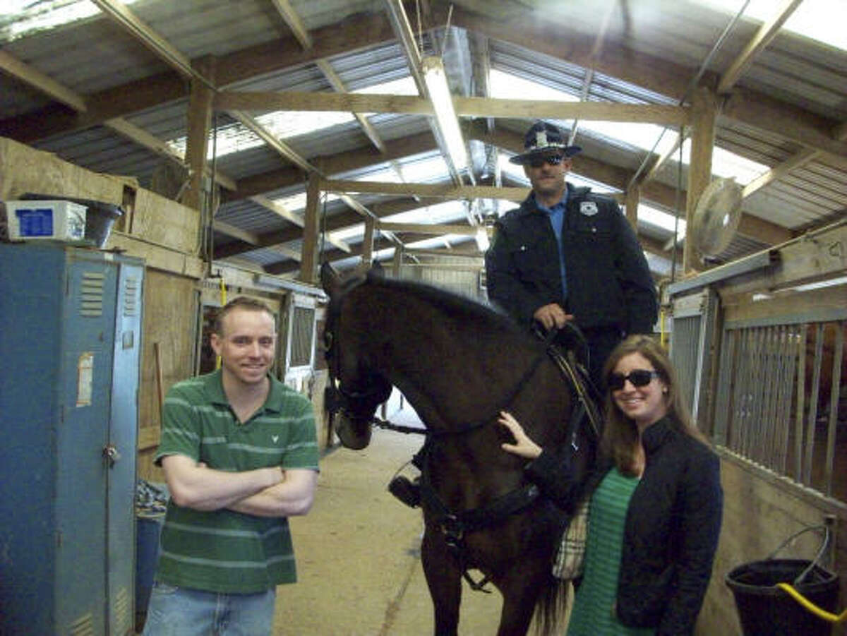 Cop on a horse and a team member - H-Team.