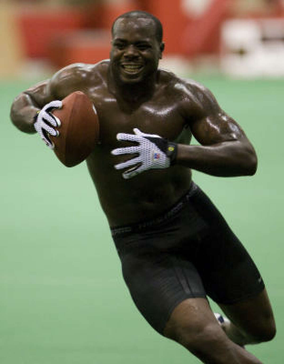 University of Houston football player Phillip Hunt runs through drills for NFL scouts during the UH Pro Day Friday.