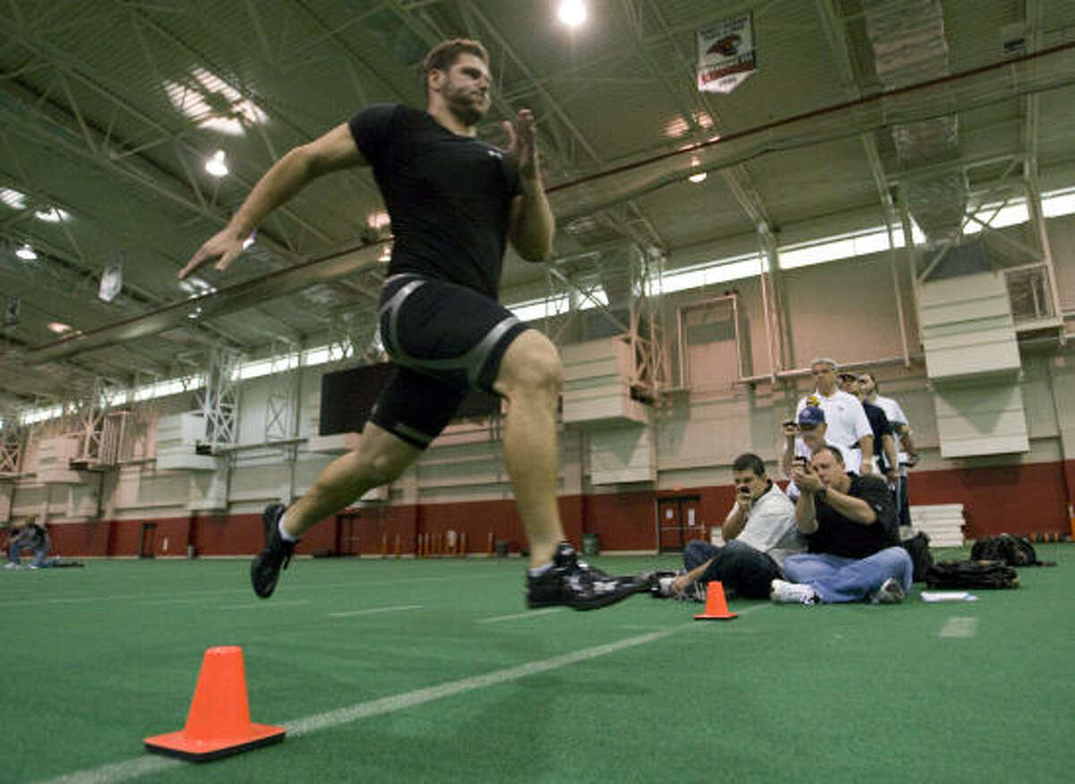 University of Houston football player Sebastian Vollmer sprints across the finish line at the end of a 40-yard dash for NFL scouts during the UH Pro Day.