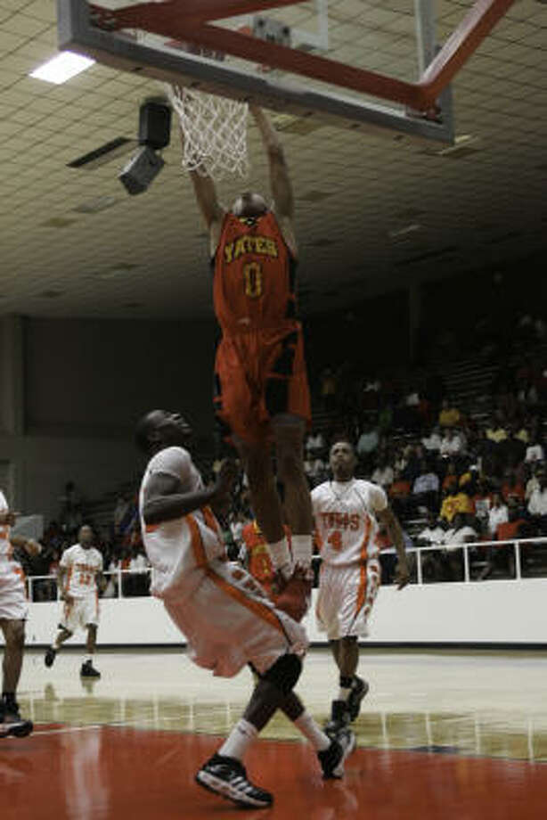 YATES 98, TEXAS CITY 59: Joseph Young of Yates goes up for two against Texas City on Friday, Feb. 27. Photo: Matthew White, For The Chronicle