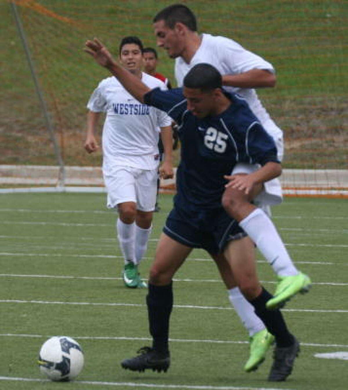 Aldine's Jairo Aguilar (25) fights off a Westside defender.
