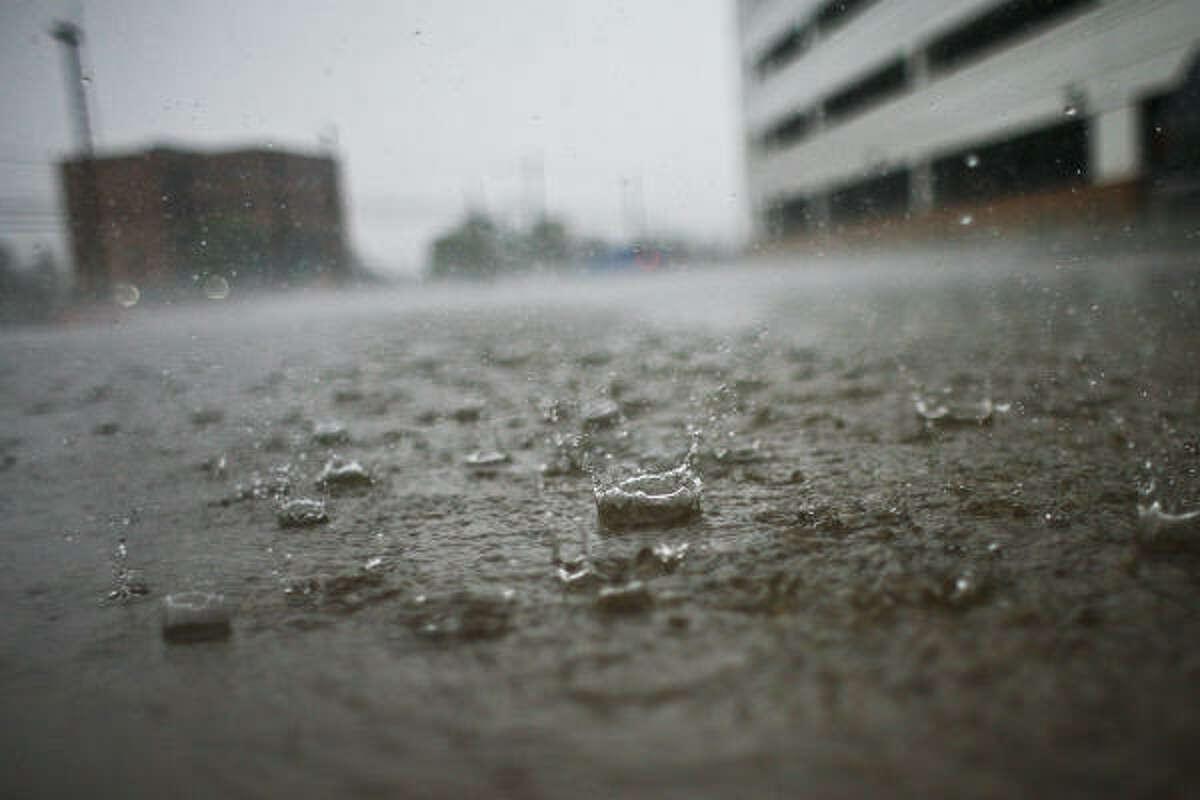 Rain drop fall in a parking lot in Houston.