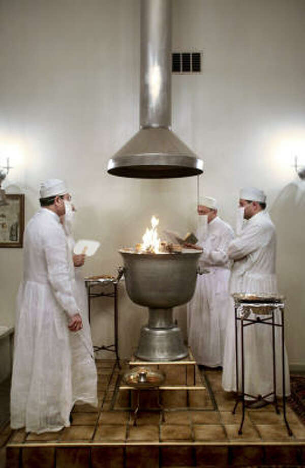 ZOROASTRIANISM: Zoroastrianism pre-dates Christianity and Islam, and many historians say it influenced those faiths, and cross-fertilized Judaism as well, with its doctrines of one God, a dualistic universe of good and evil and a final day of judgment. The sacred fire, seen here, is a central symbol of Zoroastrianism. Photo: SALLY RYAN, NYT