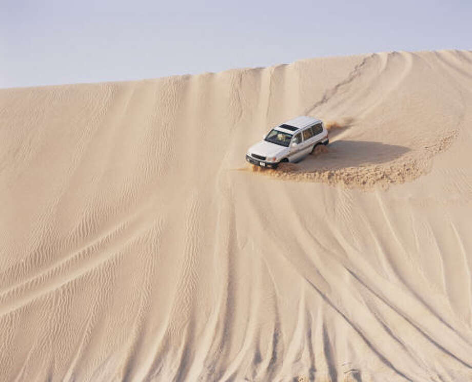 Dune bashing is part of the fun in Qatar. Riders can expect a roller-coasterlike good time traversing the sand dunes. Photo: Getty Images | Gulf Images RM