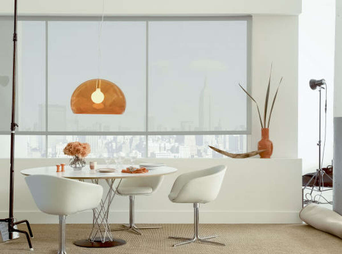 Solar shades from The Shade Store reflect heat but do not block views.