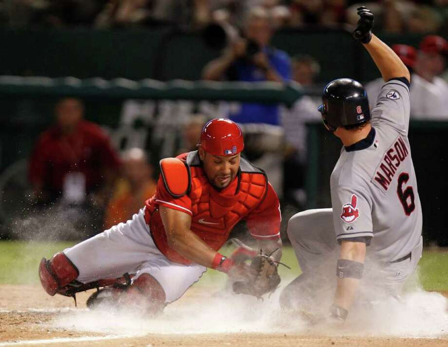 Cleveland Indians baserunner Lou Marson (6) slides safely in front of Texas Rangers catcher Yorvit Torrealba, left, during the seventh inning of a baseball game in Arlington, Saturday, August 6, 2011. Photo: Mike Fuentes/Associated Press