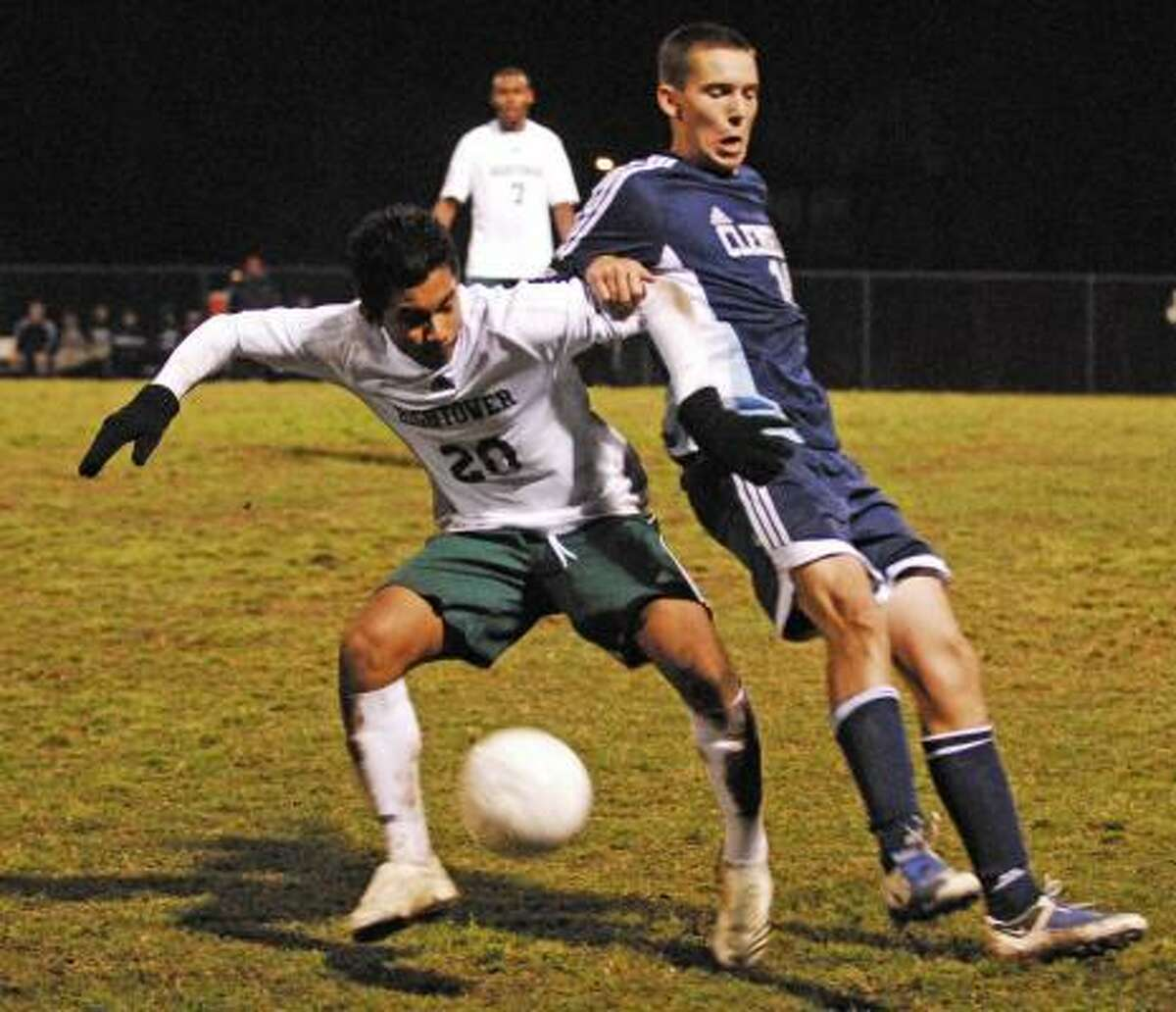 CLEMENTS 2, HIGHTOWER 0: Jorge Escobar, No. 20, of Hightower and William Morse, No. 14, of Clements fight for the ball in the second half of their game at Hightower on Friday, March 13. Clements won 2-0.