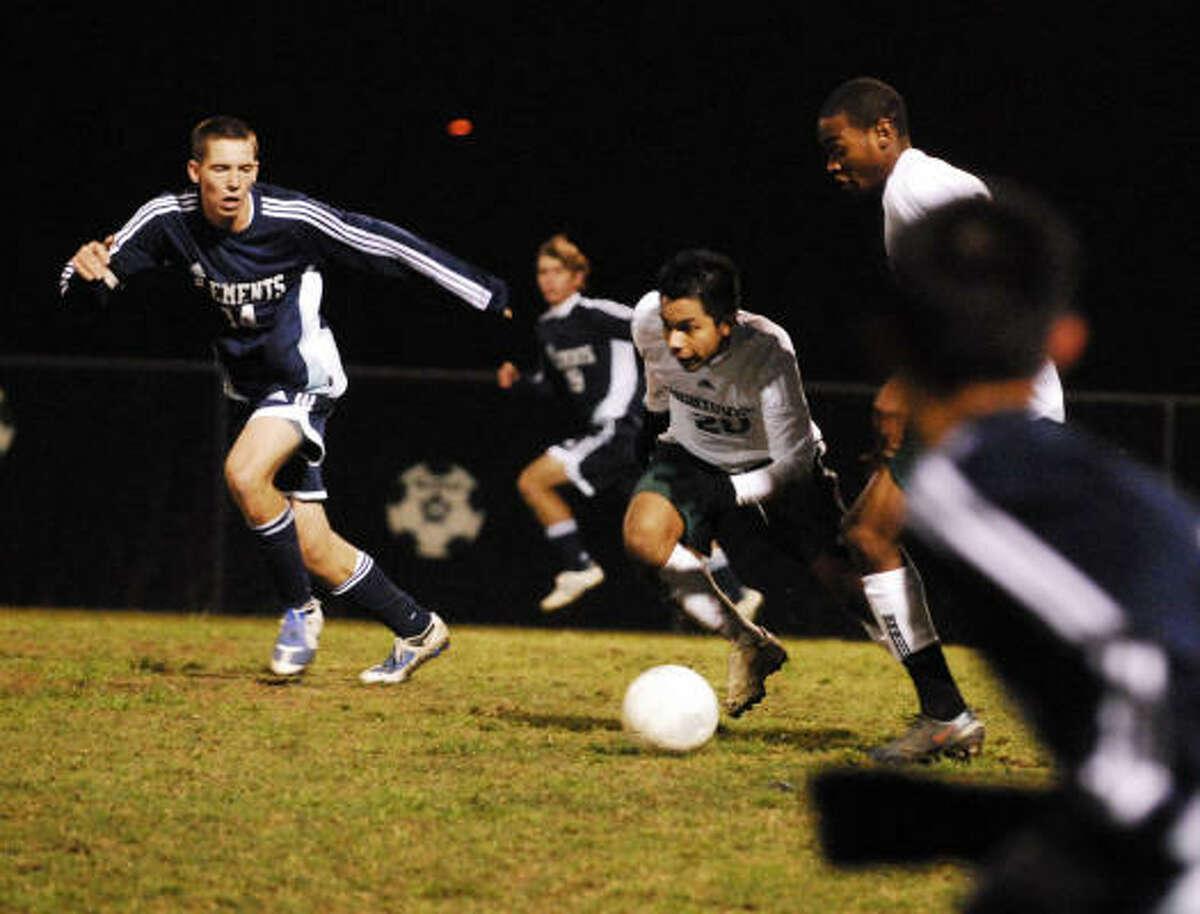 Senior midfielder William Morse of Clements challenges Jorge Escobar of Hightower.