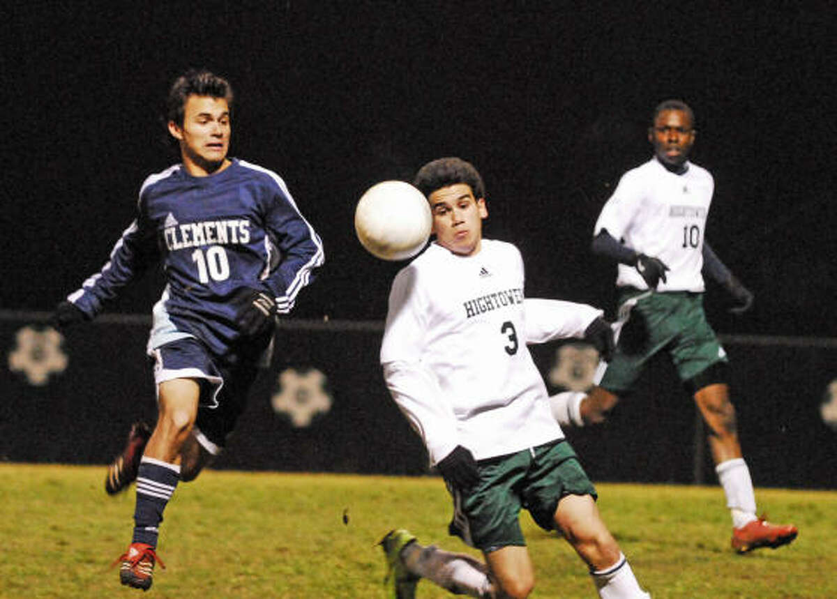 Junior forward Pablo Morillo (#10) of Clements and Edgar Mora (#3) of Hightower race to control the ball. At right is Yannick Iwunze (#10) of Hightower.