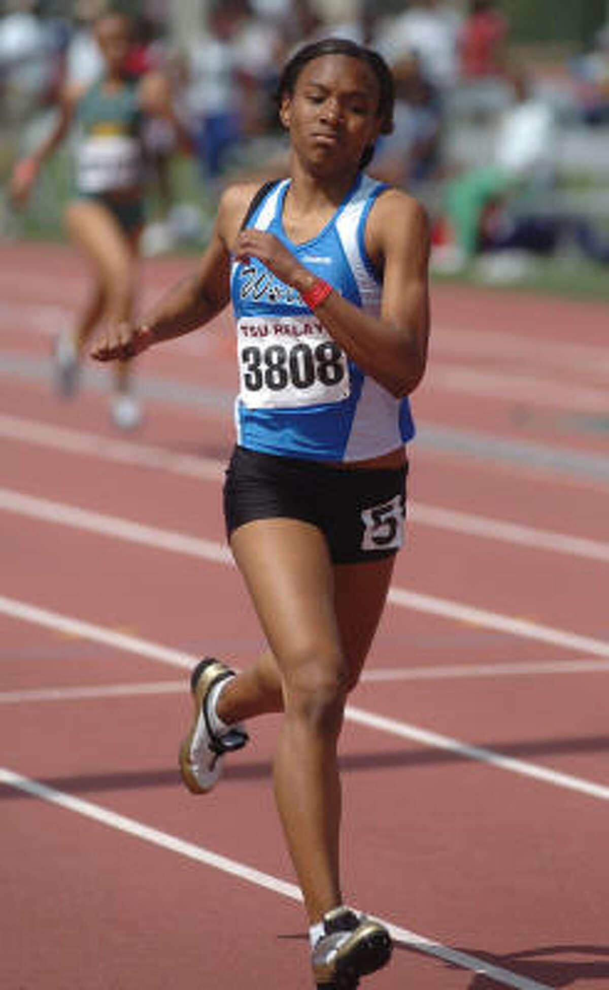 Lauren Reese of Westside competes in the 400-meter dash.