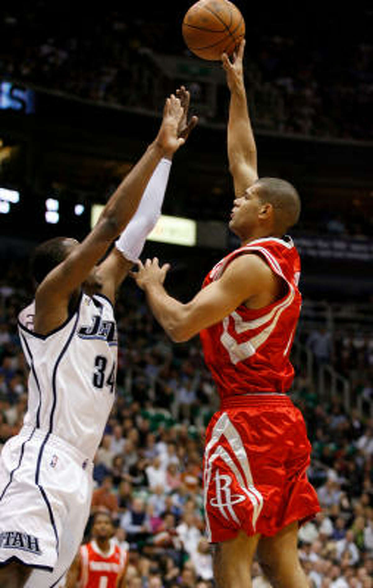 Houston Rockets forward Shane Battier puts a shot over the arms of Utah Jazz forward C.J. Miles.