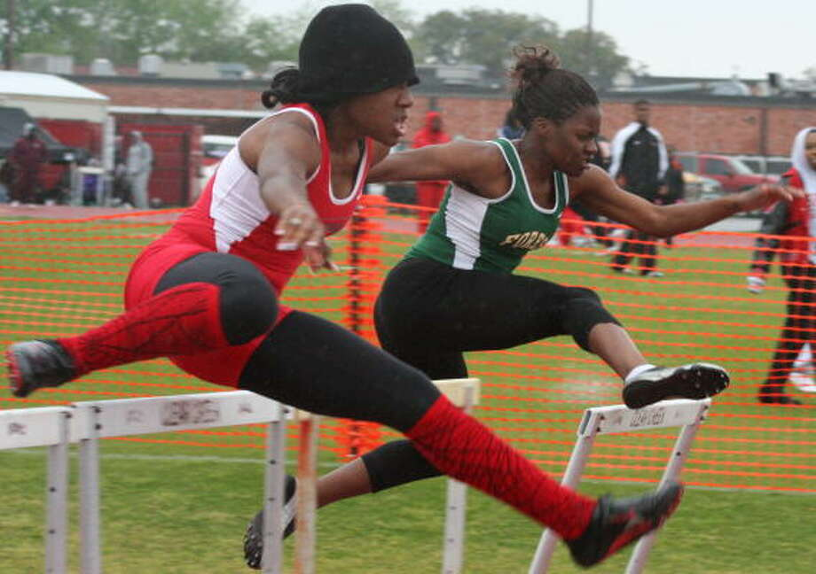 100-meter hurdle action Photo: Gerald James, For The Chronicle