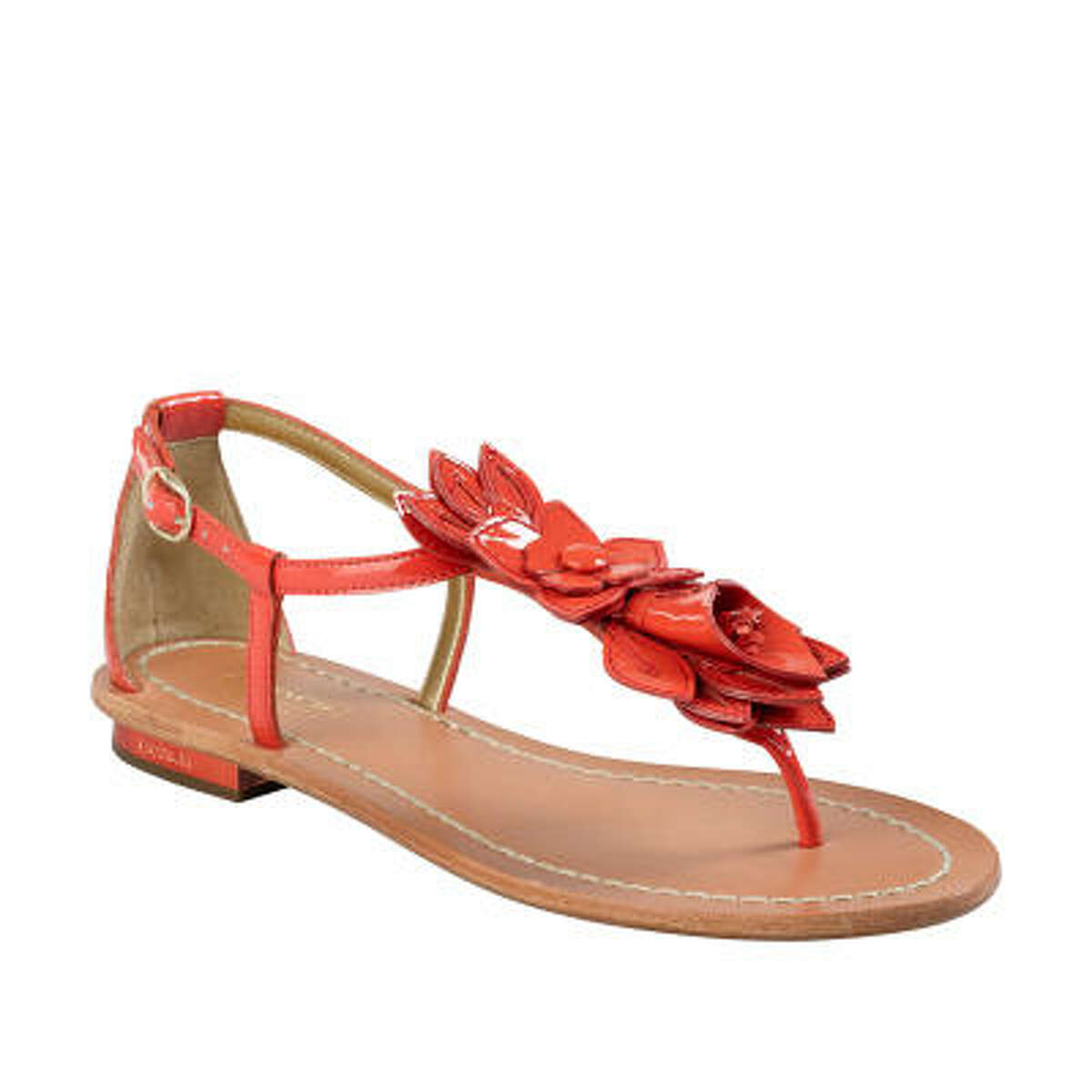 Flowers add a spring touch to an orange sandal from Coach.