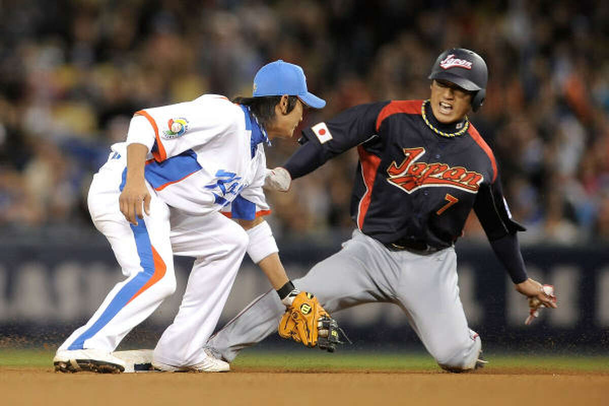 Monday, March 23Finals: Japan 5, Korea 3: Hiroyuki Nakajima #6of Japan steals second base under the tag Young Min Ko #14 of Korea in the seventh inning.