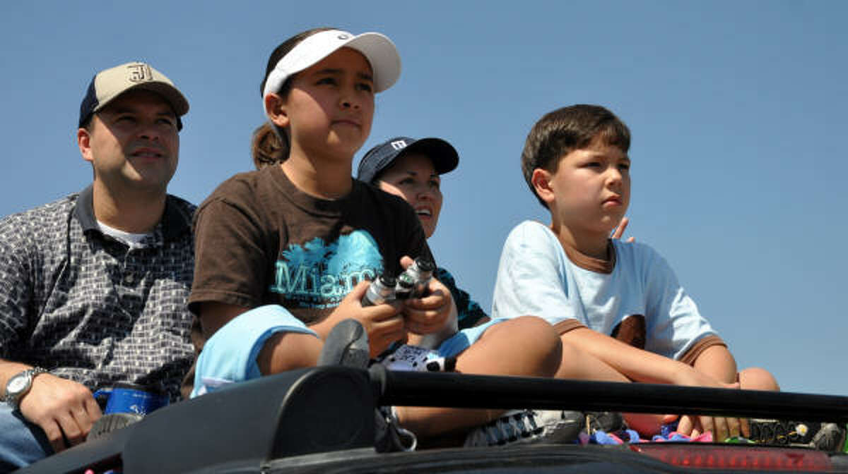 The Cuadra family uses its Chevy Suburban as a platform to watch the concert.