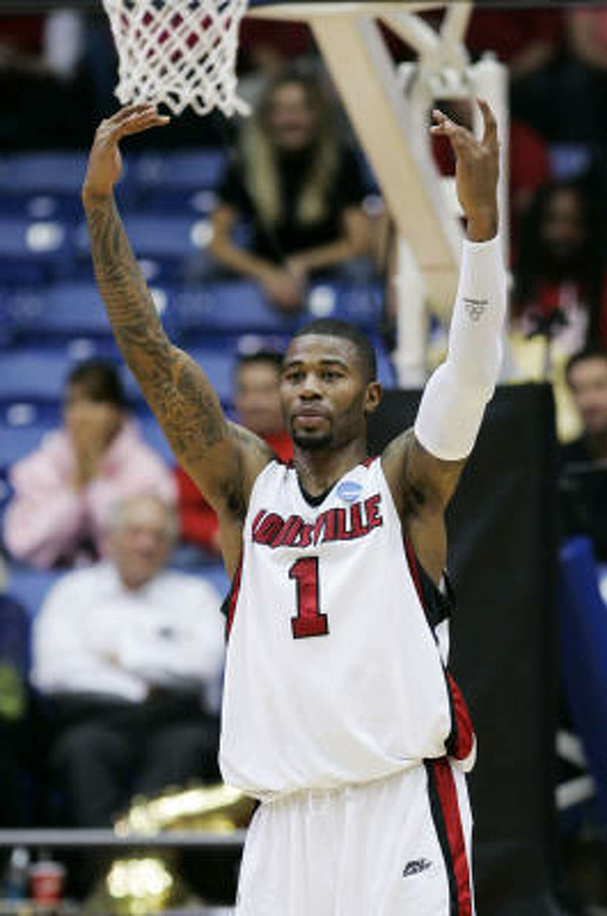Midwest Regional: Louisville 79, Siena 72 Louisville's Terrence Williams celebrates a 79-72 win over Siena.