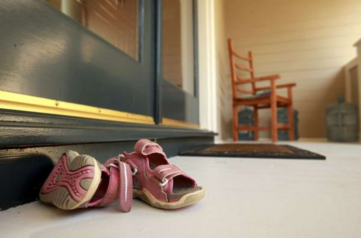 A pair of children's shoes were still sitting on the Jacobsons' front porch.