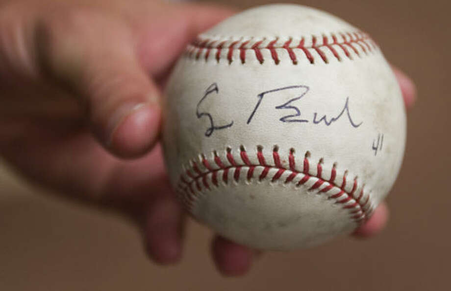 Signature of the southpaw George H.W. Bush on the baseball of righthander Chris Sampson. Photo: Smiley N. Pool, Houston Chronicle