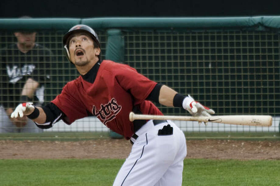 Kaz Matsui bunts for a sacrifice Astros' victory over the Florida Marlins. Photo: Smiley N. Pool, Houston Chronicle
