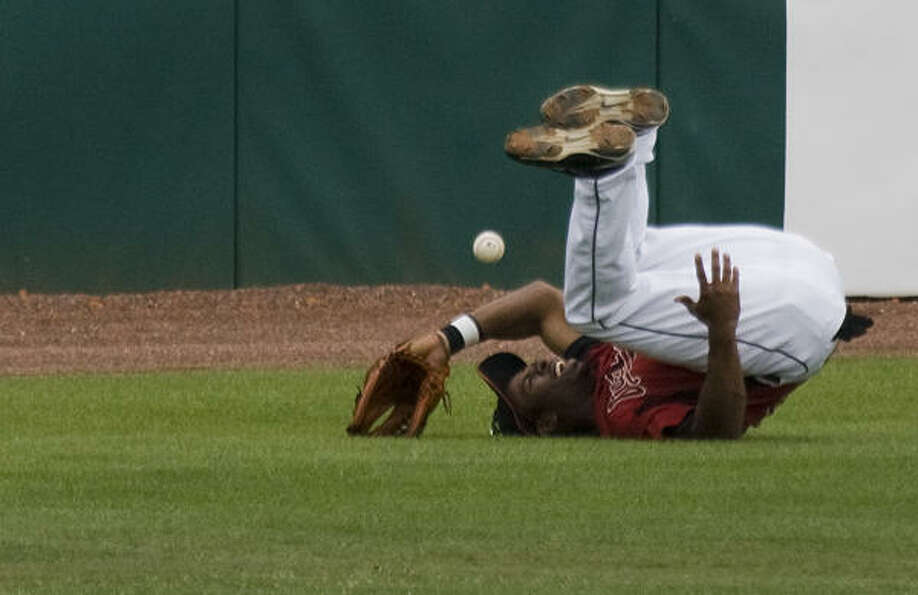 Astros center fielder Michael Bourn tumbles as he dives for what would be an inside-the-park home ru