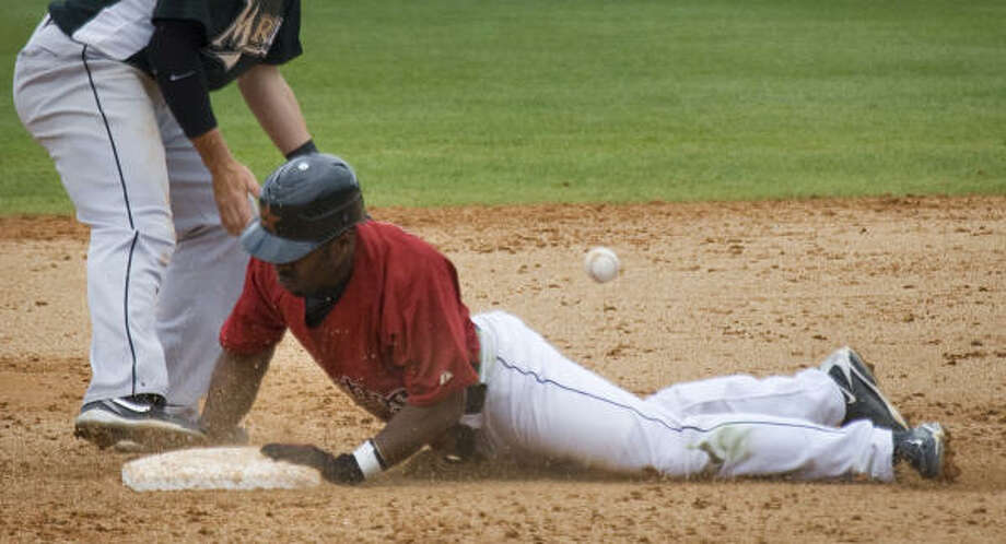 Bourn's steal of second base did some good in making up for the defensive mistake. Photo: Smiley N. Pool, Houston Chronicle