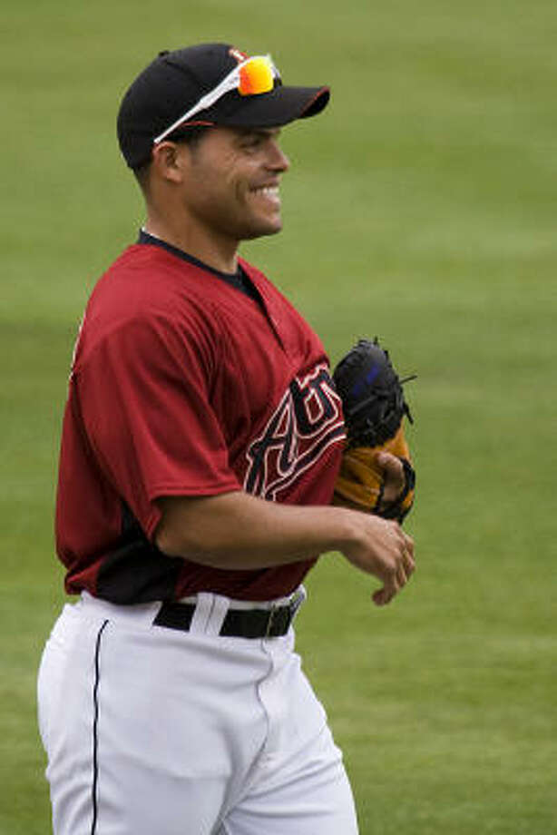 New catcher Ivan Rodriguez has had no trouble getting in on the joking around. Photo: Smiley N. Pool, Houston Chronicle