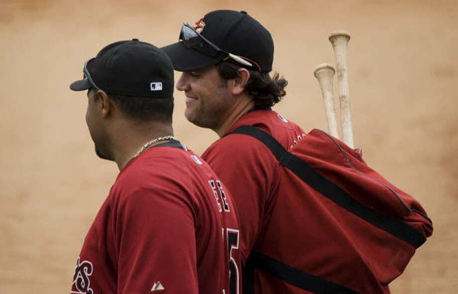 Lance Berkman, right, and Carlos Lee laugh as they leave the field. Photo: Smiley N. Pool, Houston Chronicle
