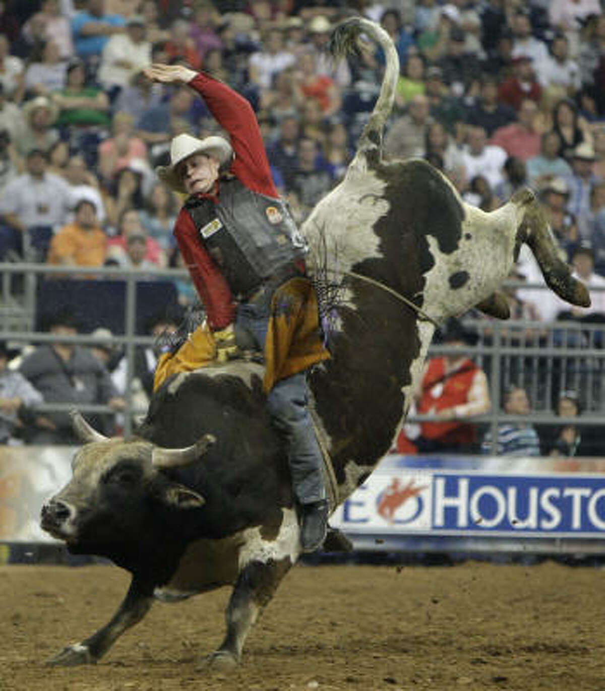 Cory Melton of Tolar rides a bull named Grinch during Xtreme Bulls at the Houston Livestock Show and Rodeo.