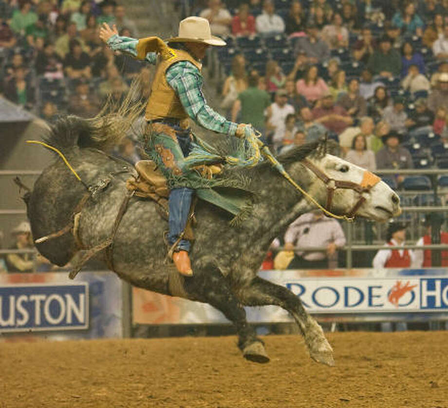 """Dustin Flundra rides """"Current Affair"""" in the saddle bronc event at the Houston Livestock Show and Rodeo. Photo: Steve Campbell, Houston Chronicle"""