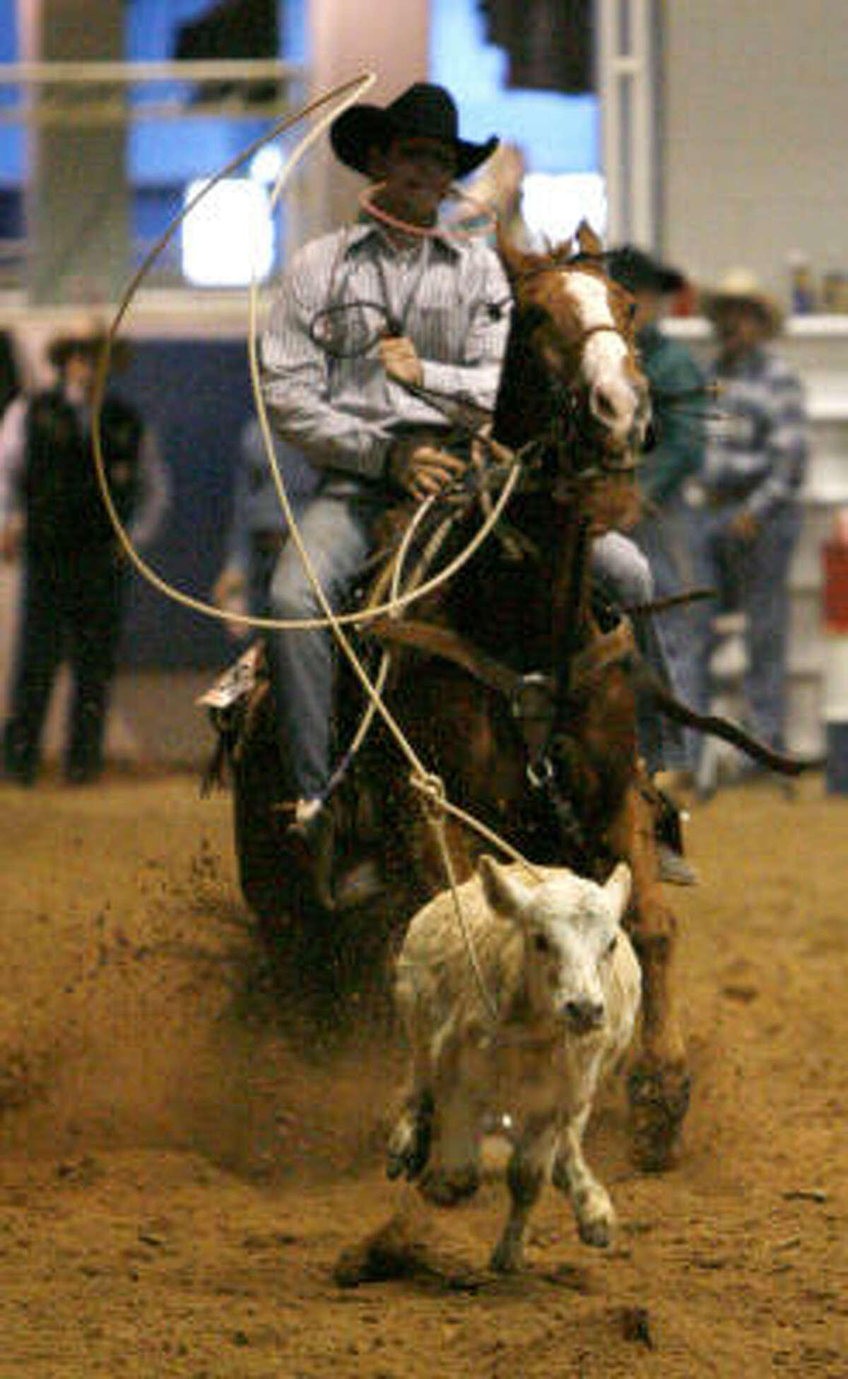 Matthew Love, riding Doc's Dextrose, goes after a calf during the Youth Calf Roping event.
