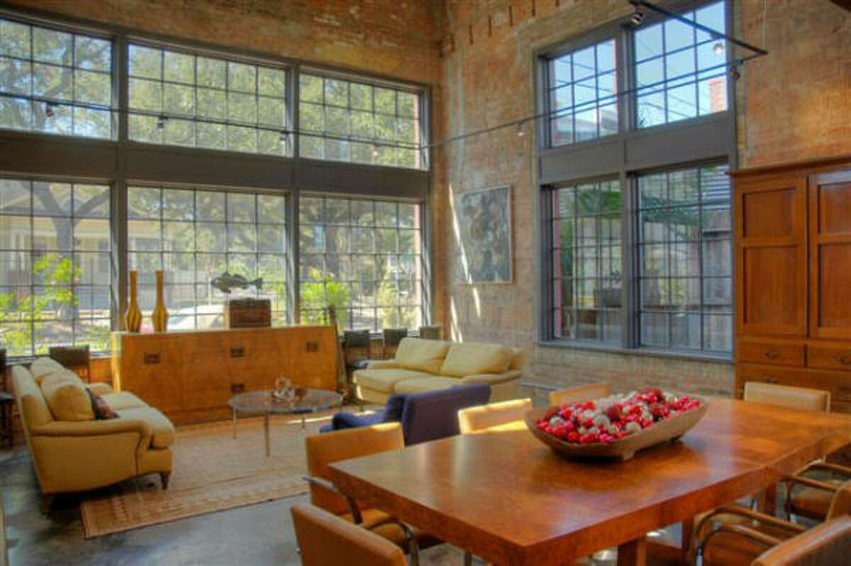 It has an open living plan with exposed brick and reclaimed wood.