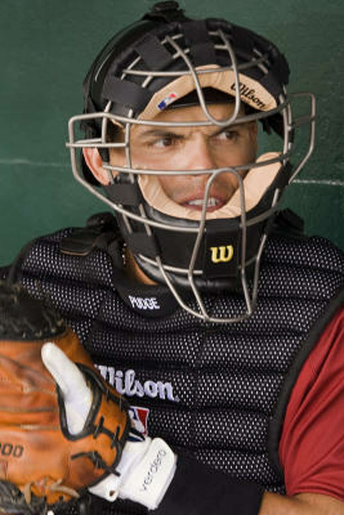 Catcher Ivan 'Pudge' Rogdriguez waits to take the field prior to he first spring training game with the Astros.