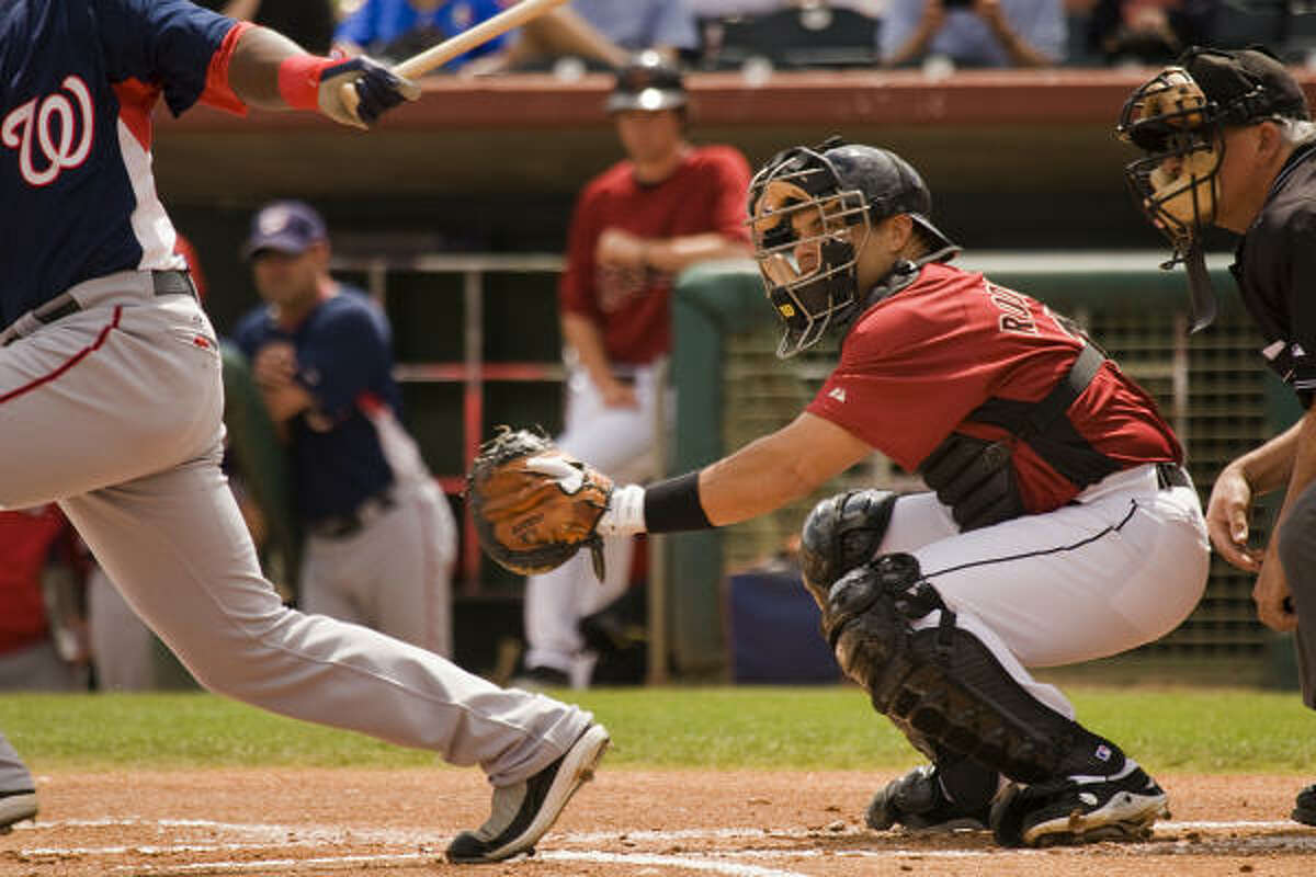 Ivan 'Pudge' Rogdriguez works behind the plate in the first inning of his first spring training game with the Astros.