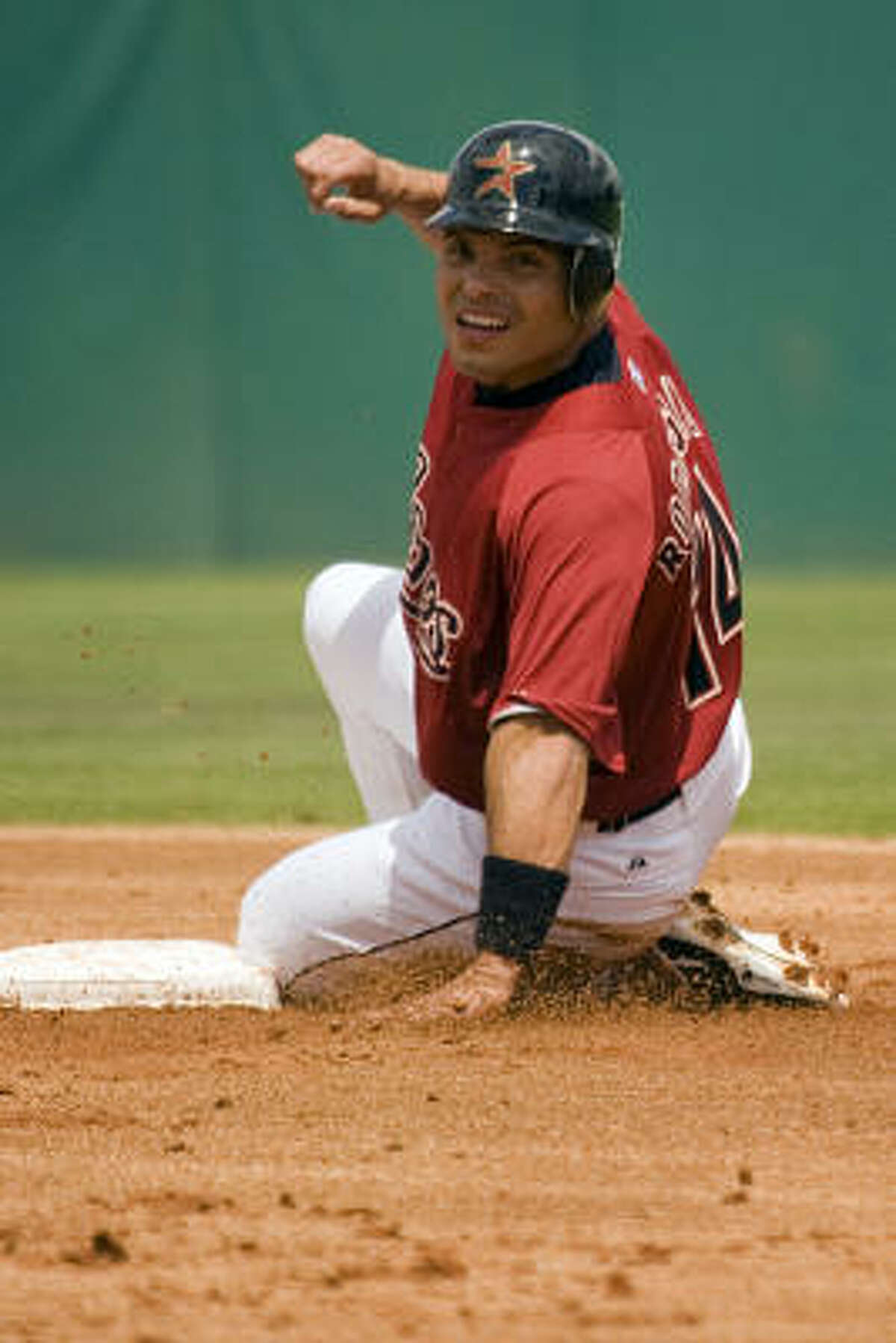 Ivan 'Pudge' Rogdriguez slides into second base after being forced out on a grounder during the first inning.