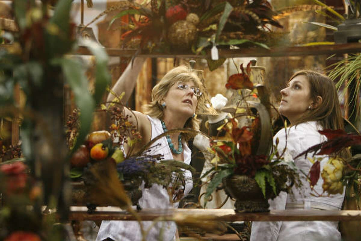 Sharon Tuttle and daughter Kelly Tuttle view artificial flower arrangements at the Houston Home Show in the George R. Brown Convention Center on Friday.