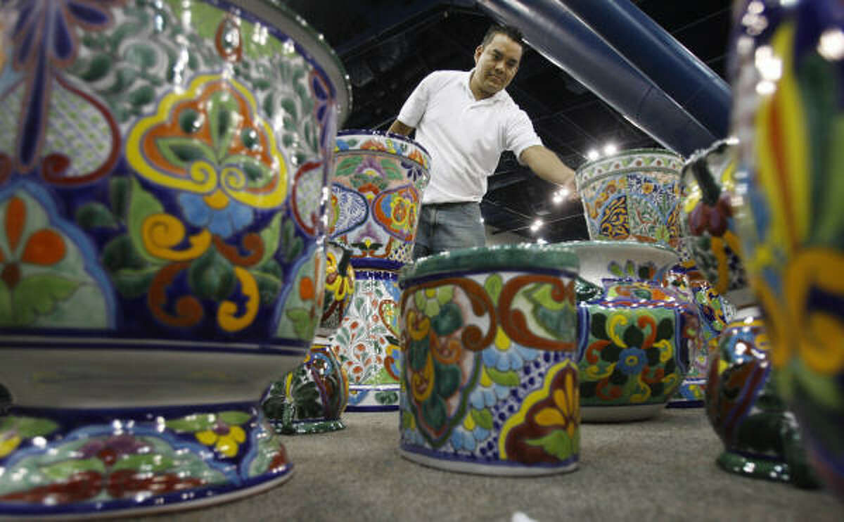 Adolfo Redondo Perez, of Azulejos TIle Company, unpacks colorful vases for the Houston Home Show in the George R. Brown Convention Center on Friday.
