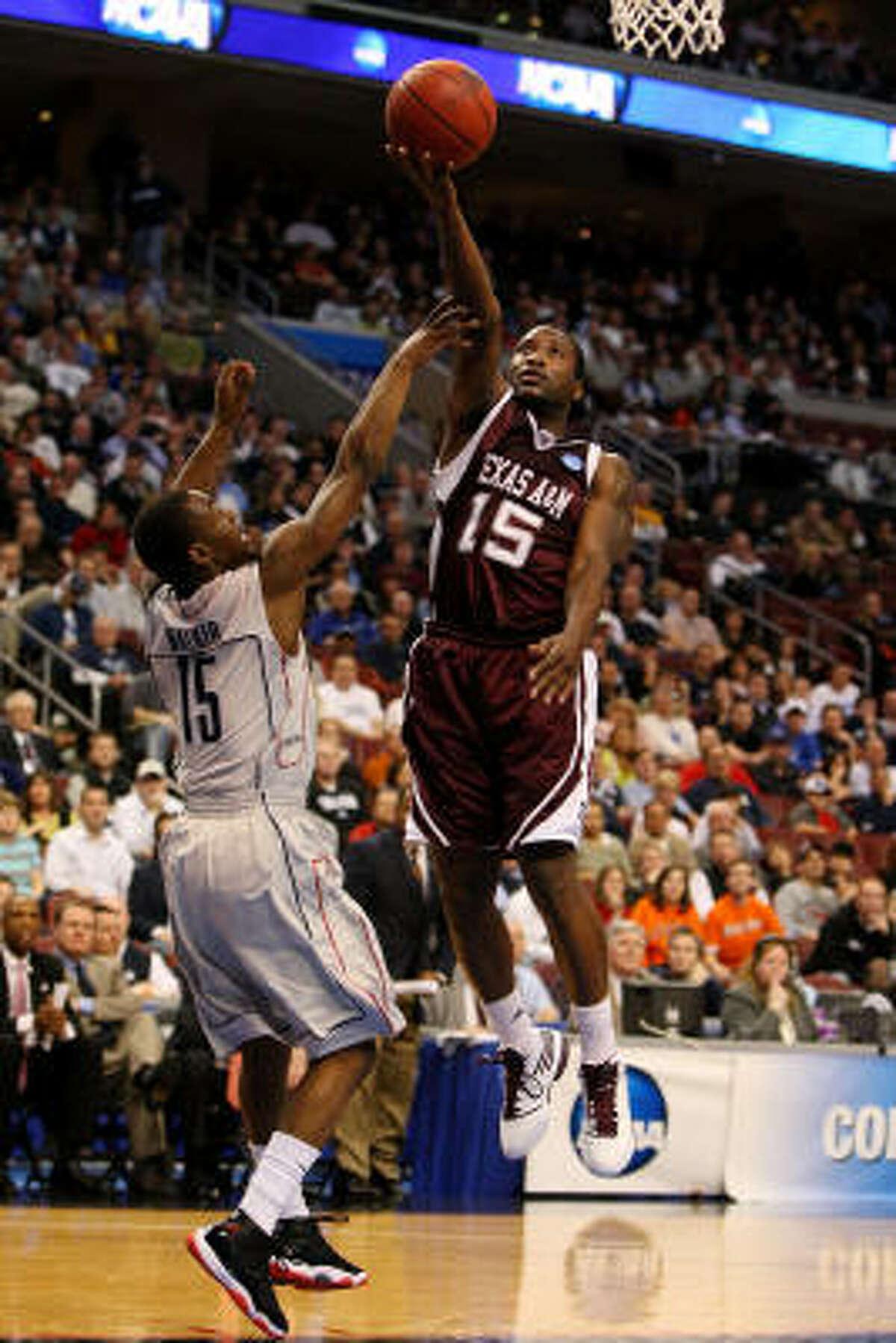 West Regional: Connecticut 92, Texas A&M 66 Texas A&M's Donald Sloan shoots against Kemba Walker.